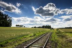 Empty Rail Track with Blue Sky. And Green Field stock image