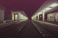 Empty railroad platform at night