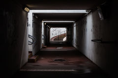 Empty railroad station underpass. With lights and shadows Stock Images