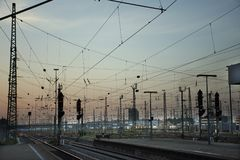 Empty railroad tracks of Mannheim Hauptbahnhof railway station. With traffic road in morning time on August 29, 2017 in Mannheim, Germany Stock Photography