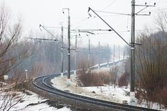 Empty railroad turn in winter fog Royalty Free Stock Images