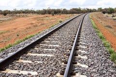 Empty railway through Australian outback. Central Australia. Railroad through desert royalty free stock image
