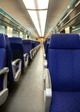 Empty railway carriage with blue seats Stock Photos