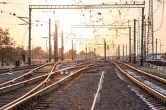 An empty railway sorting station or terminal with lots of junction, crossroads, semaphore showing red or green light, in a bright Stock Image