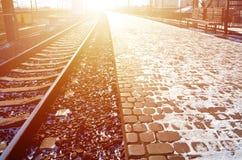 Empty railway station platform for waiting trains `Novoselovka` in Kharkiv, Ukraine. Railway platform in sunny winter da. Y Royalty Free Stock Images