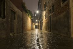 Rainy street by night stock images