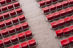 Empty range of red seats in a stadium Royalty Free Stock Photography