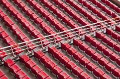 Empty range of red seats in a stadium Stock Photos
