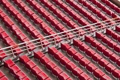 Empty range of red seats in a stadium Stock Photos