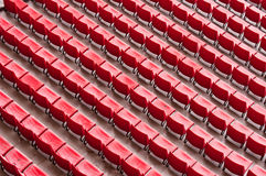 Empty ranges of red seats in a stadium Royalty Free Stock Photo