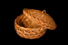 Empty rattan bread plate. Isolated on black background stock image
