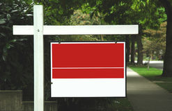 Empty Realty Sign. An empty red and white realty for sale sign stock photo