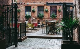 Empty reastaurant, garden in city centre royalty free stock image