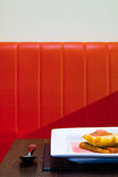 Modern desert and red seat in funky restaurant Royalty Free Stock Photo