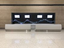 Empty reception counter with TV panels. Direct front view of a empty generic reception counter with LED panels screens stock photo