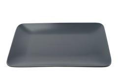 Empty rectangular black plate isolated on white background Stock Photography