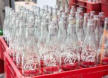 Empty recycle bottles of Coca Cola in red plastic box Royalty Free Stock Photo