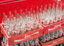 Empty recycle bottles of Coca Cola in red plastic box Stock Photos