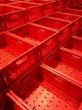 Empty red boxes at market. On row and three levels royalty free stock photography