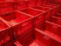 Empty red boxes at market. Three row empty red boxes at market stock images