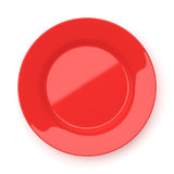 Empty red ceramic round plate isolated on white. Background stock photo