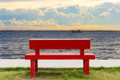 Empty red chair and twilight sea view background Stock Image