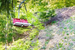 Empty red chairlift in the mountains Royalty Free Stock Photo