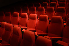 Empty red cinema chairs. Dark tone Royalty Free Stock Photos
