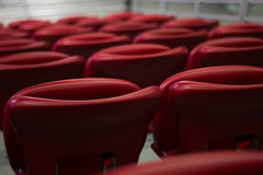 Empty Red Concert Chairs. Rows of empty red concert chairs Royalty Free Stock Images