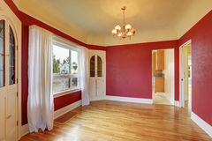 Empty red dining room interior with built-in cabinets. Hardwood floors . Northwest, USA Royalty Free Stock Image