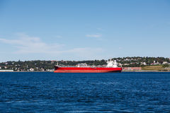 Empty Red Freighter on Blue Water Stock Photography