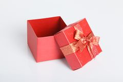 An empty red gift box with the lid off. On white background Royalty Free Stock Photos
