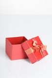 An empty red gift box with the lid off. On white background Royalty Free Stock Photography