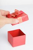 An empty red gift box with the lid off. On white background Stock Images