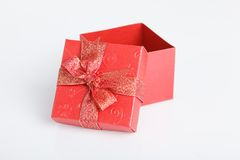 An empty red gift box with the lid off Stock Image