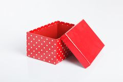 An empty red gift box with the lid off. On white background Stock Photos