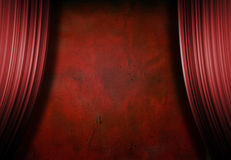Empty Red Grunge Stage. With red curtains Royalty Free Stock Photography