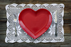 Empty red heart shaped plates with fork and knife Royalty Free Stock Photography