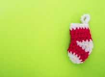 Empty red knitting. Christmas sock on green background , copy space Royalty Free Stock Photography