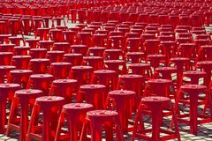 Empty red plastic chairs Stock Image