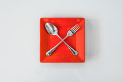 Empty red plate Royalty Free Stock Images