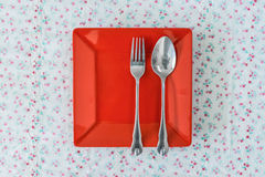Empty red plate Stock Photos