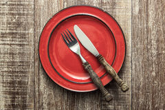 Empty red plate on wooden table. From above Royalty Free Stock Photography