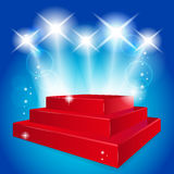 Empty red  podium illuminated lights Royalty Free Stock Photography