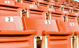 Empty red seating in sport stadium Royalty Free Stock Photos