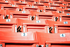 Empty red seating in sport stadium Royalty Free Stock Image