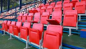 Empty red seats. Red empty plastic seats in sport stadium Stock Photos