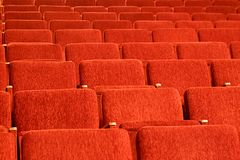Empty red seats of the auditorium. Empty red seats in the auditorium. Red chairs Stock Image