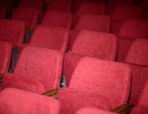 Empty red seats for cinema theater conference or concert Royalty Free Stock Photo