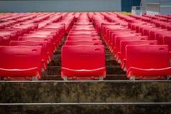Empty red seats in football stadium.  Stock Photo